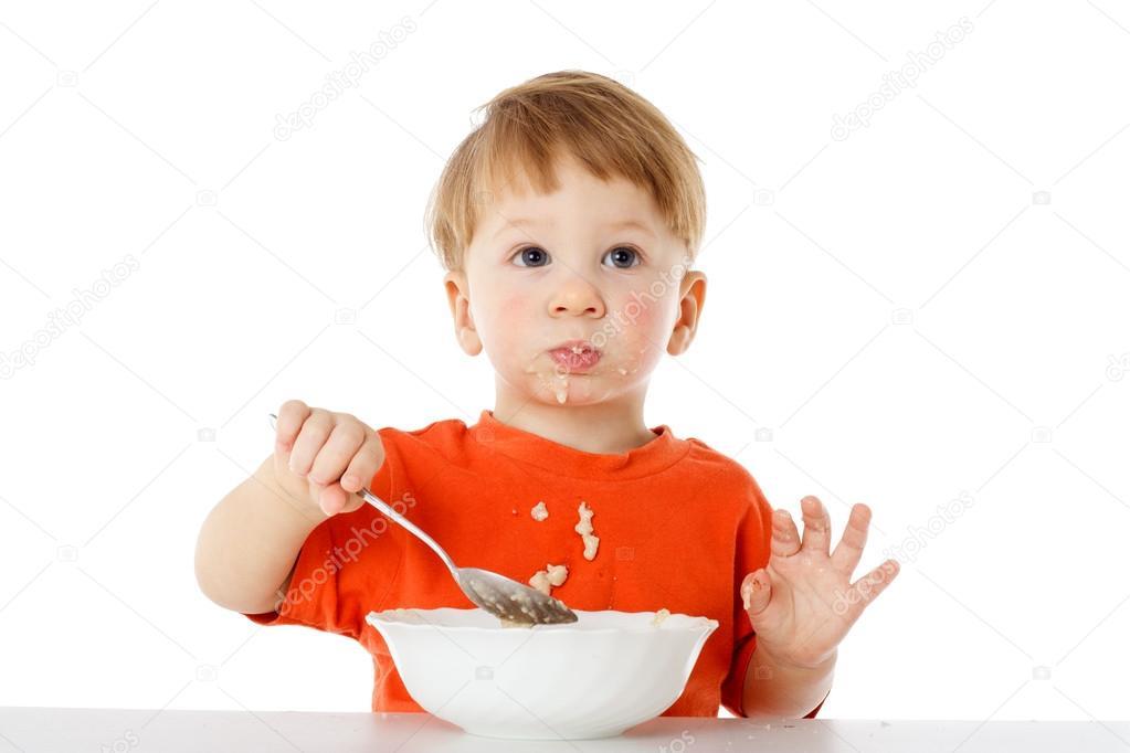 Niño Comiendo Los Copos De Avena