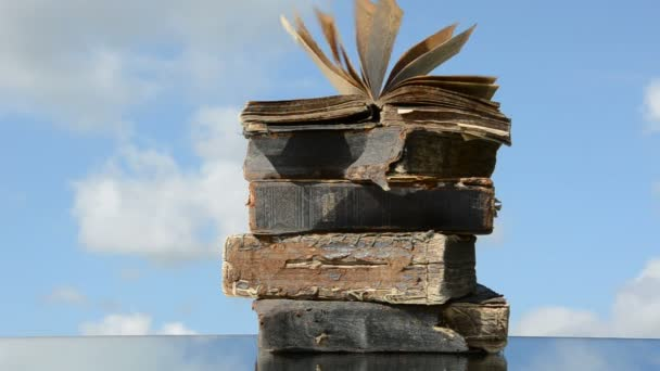Old books on mirror and wind