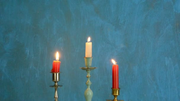 Three candlesticks with candles