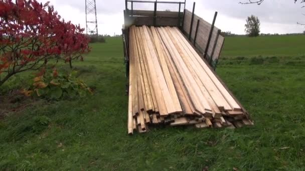 Sawn timber planks stack in truck