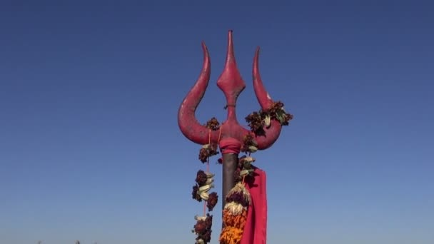 hindu god Shiva sacred trident and red flags In India