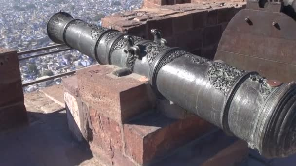Historical ornate cannon on Rajasthan blue city Jodhpur fort wall