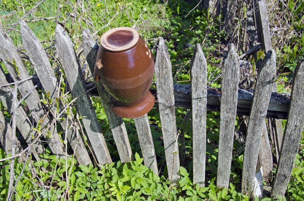 Old Broken Jar On Farm Wooden Fence