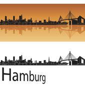 Fotografie Hamburger Skyline im orangen Hintergrund