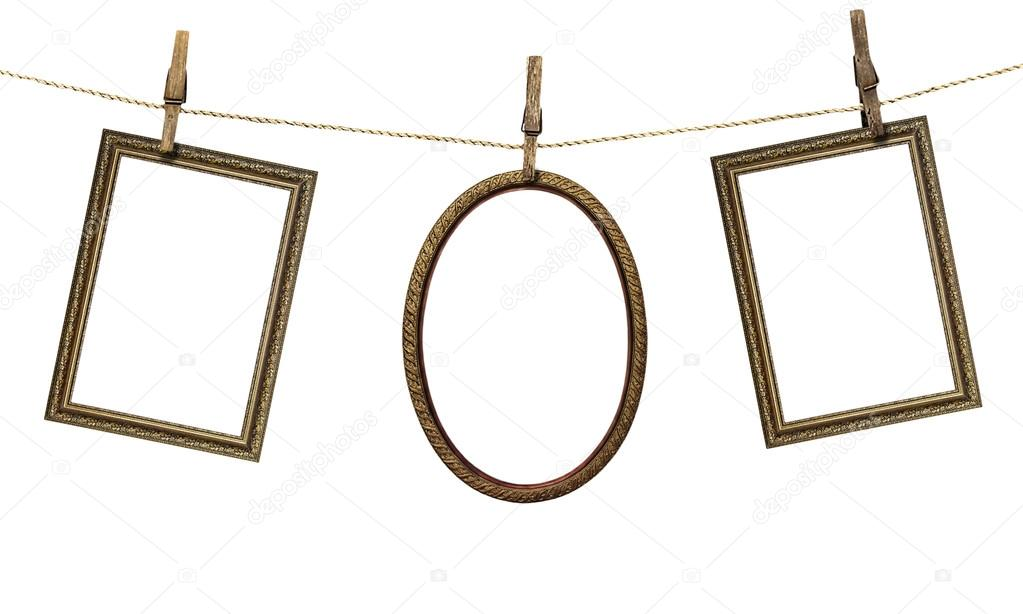 Three picture frame hanging on clothespins isolated on white bac  Stock  Photo #38756923