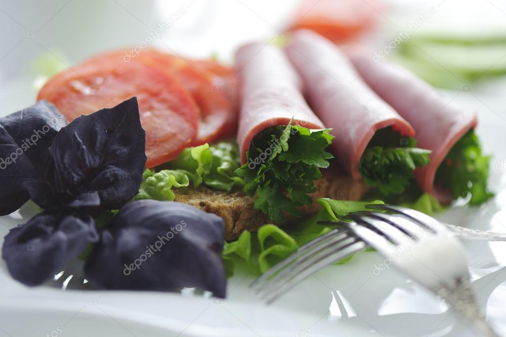 Rolled beef with vegetables and greens