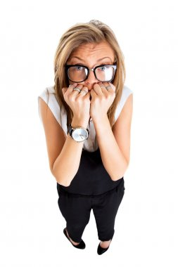 Frightened and stressed young business woman biting her fingers,