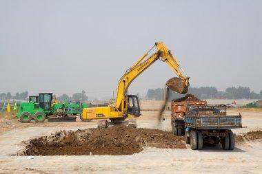 excavator and transporter