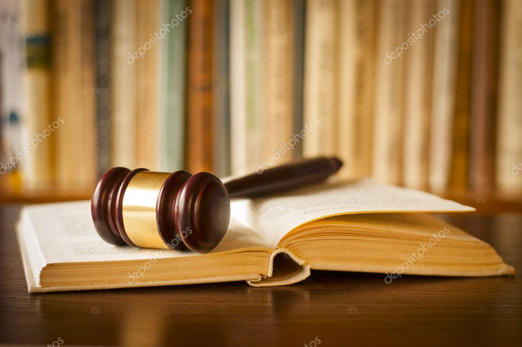 Open Law Book With A Judges Gavel Stock Photo