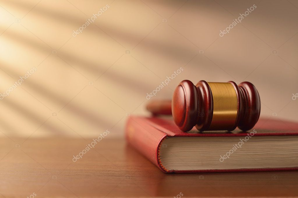 Law book and judges gavel