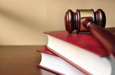 Wooden judges gavel on a law book