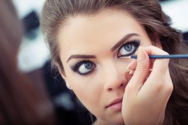 Applying liquid eyeliner