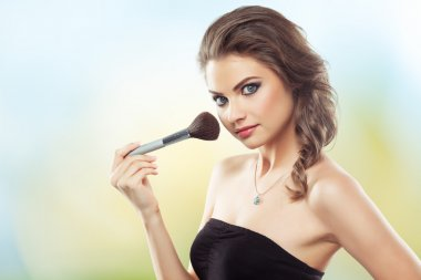 Woman with a make-up brush