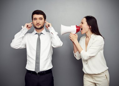 woman shouting in megaphone at the calm man