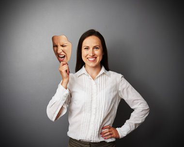 woman holding mad mask