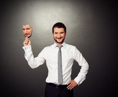 man holding sad mask