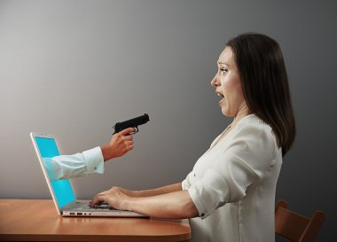 woman looking at hand with gun