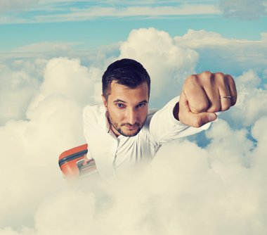 man flying through the clouds