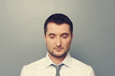 businessman with closed eyes