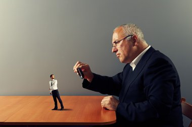 worker under magnifying glass his boss