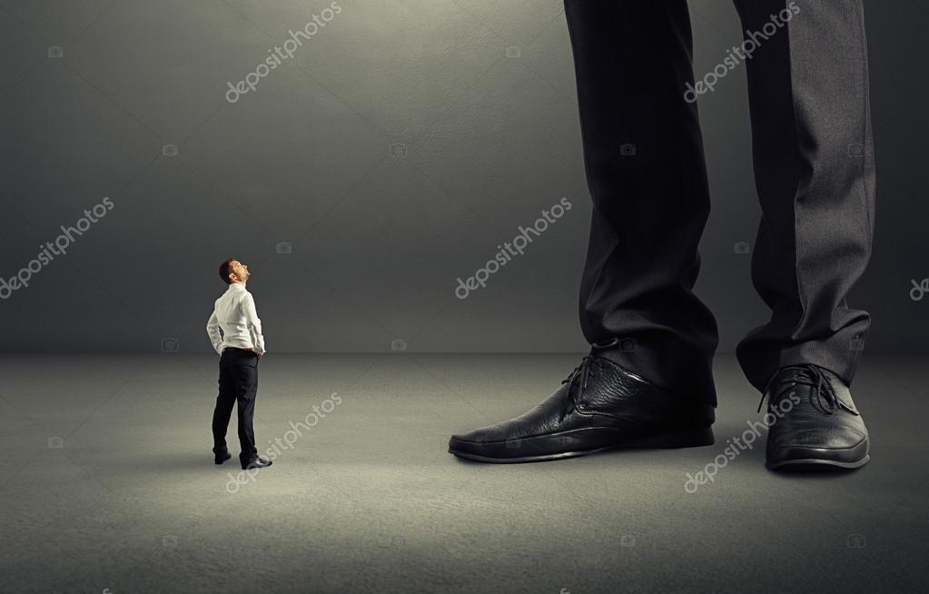 man looking at his big boss