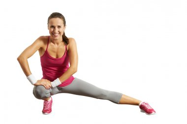 sportswoman doing stretching exersices