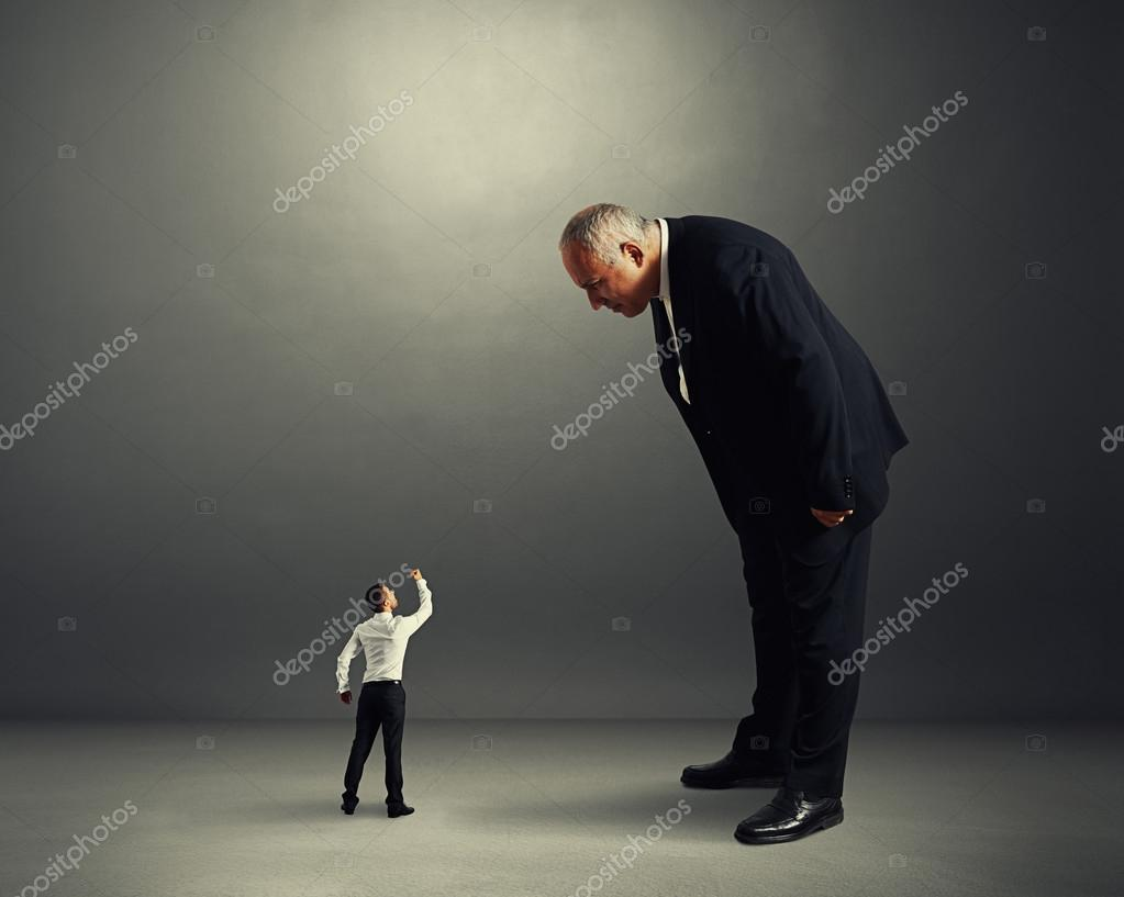 boss good looking at small worker