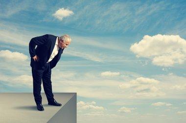 senior man standing over the precipice