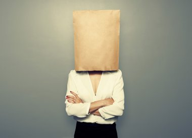woman hiding under empty paper bag