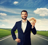 Photo businessman holding money at outdoor
