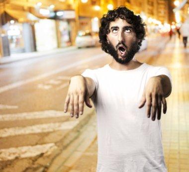 man imitating zombie