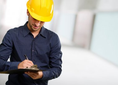 Technician Using Clipboard