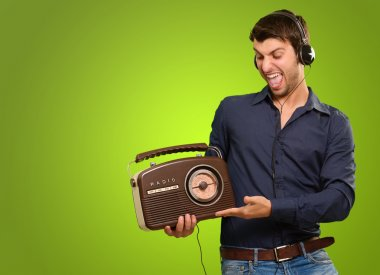 Young Man Listening To Vintage Radio