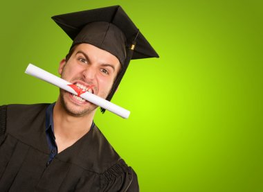 Graduate Man With Degree In Mouth