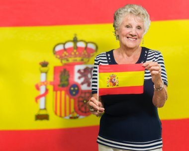 Senior Woman Holding Spain Flag