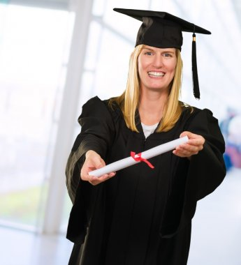 Happy Graduate Woman showing Certificate