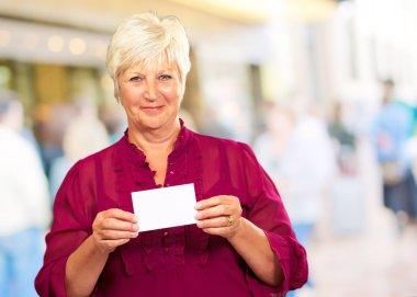 Senior Woman Holding A Card