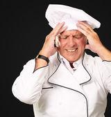 Fotografia Ritratto di chef con dolorosamente la testa