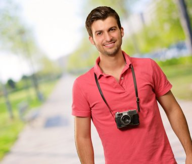 Portrait of a man wearing camera, outdoor stock vector