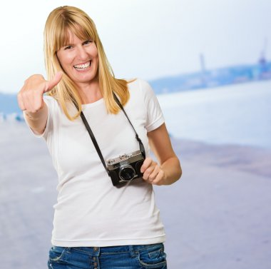 Happy Woman With Old Camera Showing Thumb Up