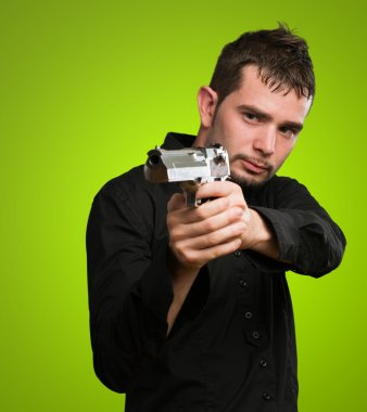 Portrait Of A Man Holding Gun against a green background stock vector