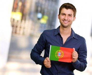 Young Man Holding Portuguese Flag