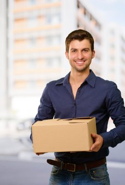 Young Man Holding Cardbox