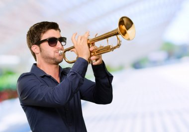 Young Man Holding Trumpet