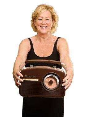 Happy Mature Woman Holding Radio
