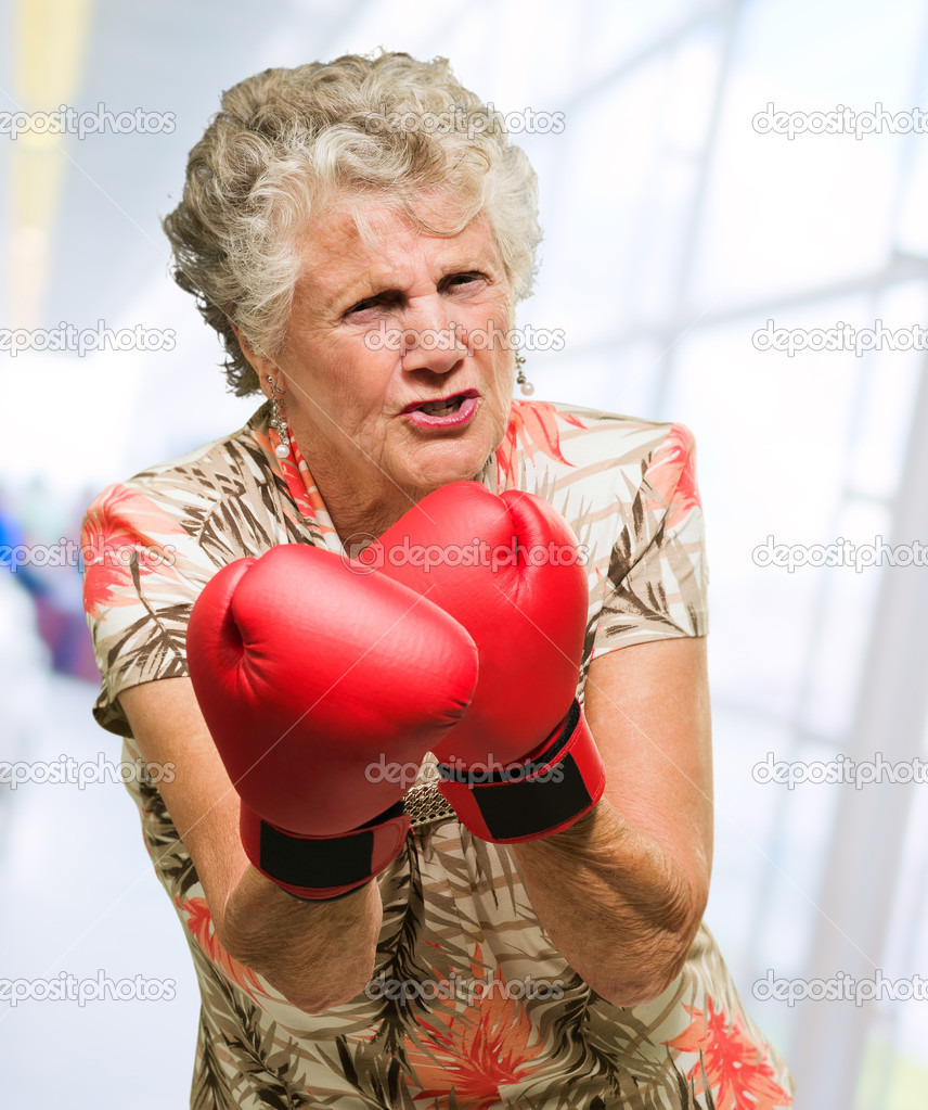 Mature woman with gloves — 1