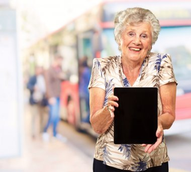 Portrait Of A Senior Woman Holding A Digital Tablet