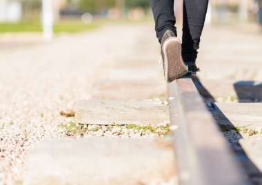 Girl Walking On The Railroad