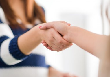 Close Up Of Two Women Shaking Hands, Indoor stock vector