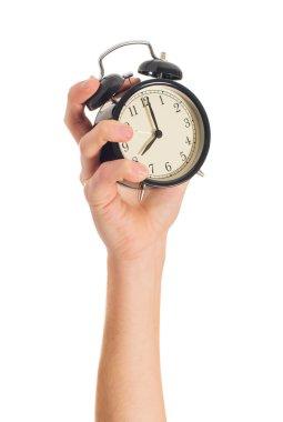 Human Hand Holding Alarm Clock